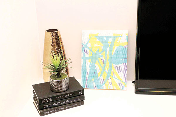 A Charles Lahti artwork displayed alongside accent pieces
