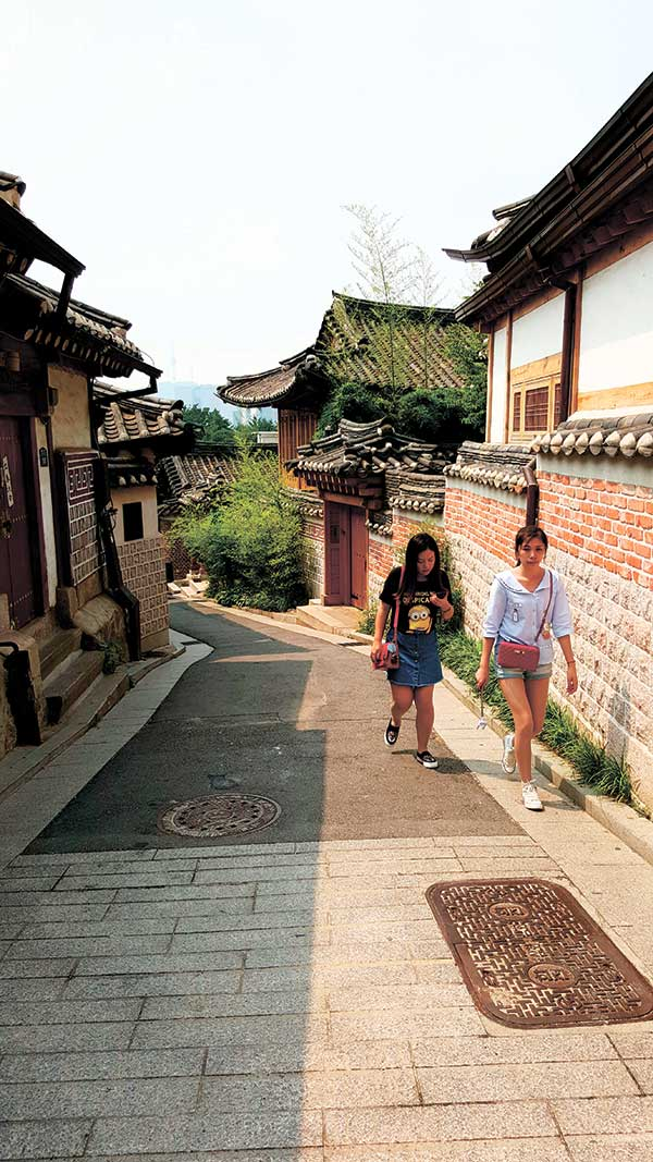 Tourists explore the Bukcheon Hanok Village