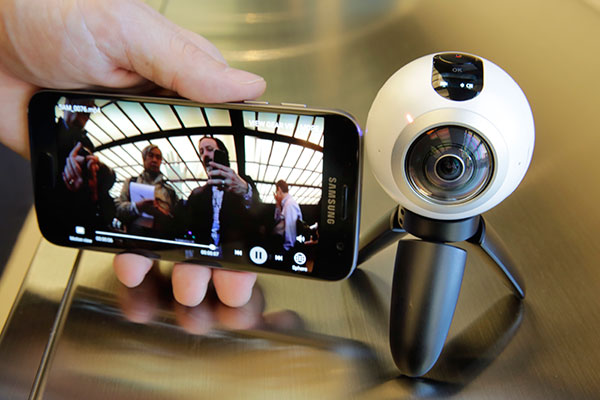 NEW CHALLENGES. Demo of Samsung Galaxy S7 Edge mobile phone and Gear 360 portable 360 degree camera, featuring two 192-degree lenses. As cameras that shoot 360-degree photos and videos become affordable, the challenge will be making shots meaningful and compelling. (AP PHOTO)