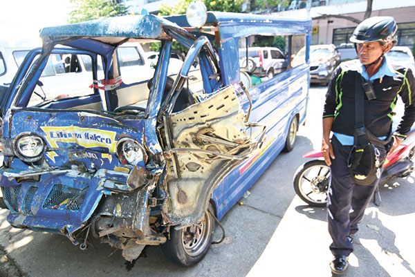WRECK. A traffic enforcer checks a public utility jeepney that figured in an accident in Cebu. Calls are being made for stricter policies concerning the roadworthiness of vehicles as well as raising the standards for professional drivers. (SUN.STAR FILE)