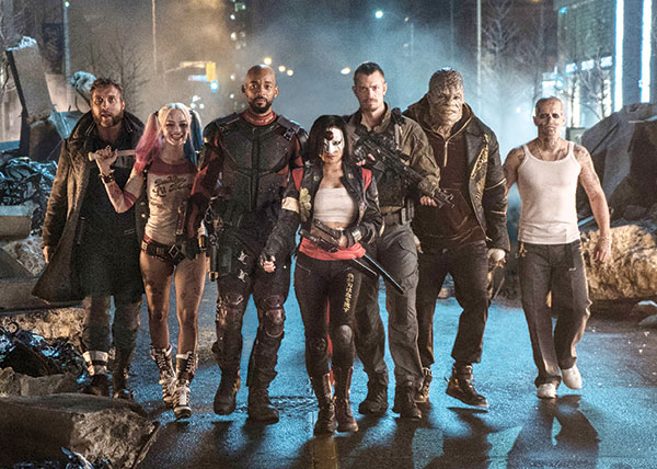"This image released by Warner Bros. Pictures shows (from left) Jai Courtney as Boomerang, Margot Robbie as Harley Quinn, Will Smith as Deadshot, Karen Fukuhara as Katana, Joel Kinnaman as Rick Flag, Adewale Akinnuoye-Agbaje as Killer Croc and Jay Hernandez as Diablo, in a scene from ""Suicide Squad."" (Clay Enos/Warner Bros. Pictures via AP)"