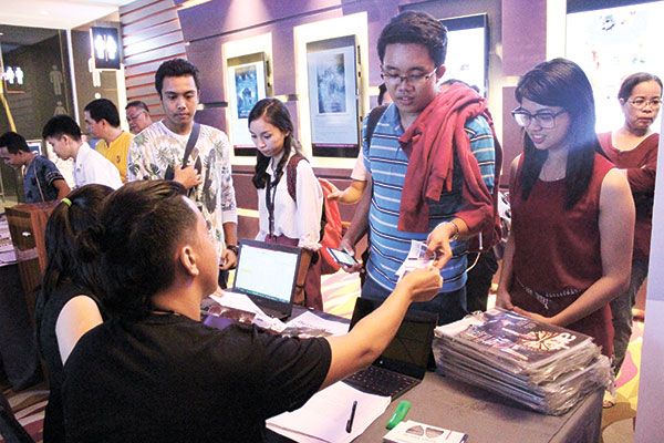 Festival attendees claiming their free reserved tickets for the event