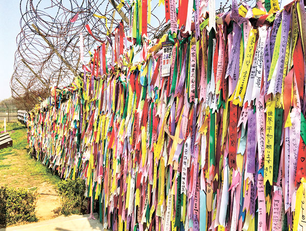 Ribbons containing messages for family members separated by war.