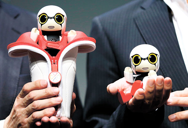 "Although it can't do much but chatter in a high-pitched voice, the new robot from Japanese automaker Toyota Motor Corp. would make for a ""faithful companion."" (AP PHOTO)"