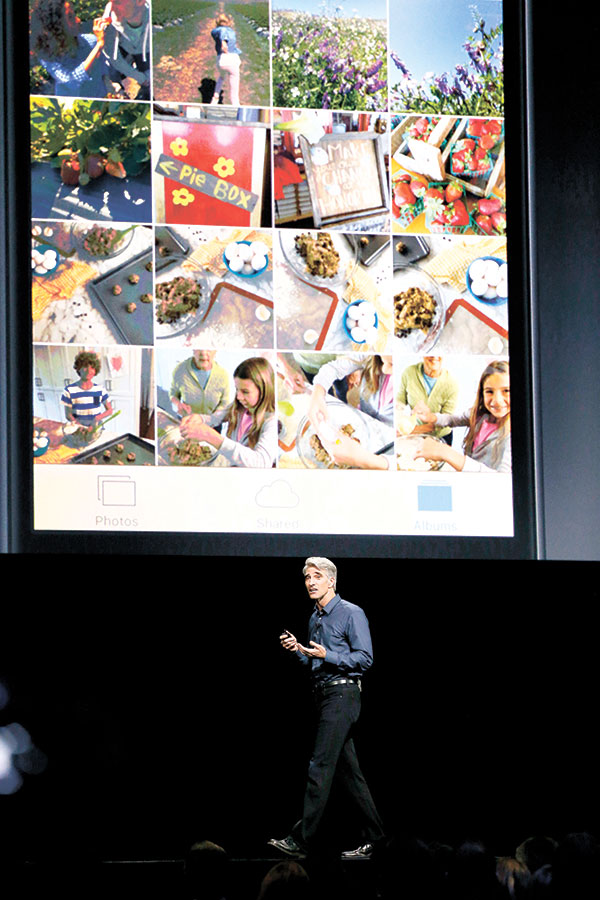 An Apple executive speaks about Photos in iOS 10 at the Apple Worldwide Developers Conference in San Francisco. With iOS 10, the Photos app has more options for searching and viewing highlights. (AP PHOTO)