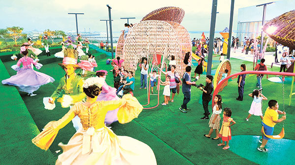 Dancers in colorful Alice in Wonderland-themed costumes welcome guests at the launch of Sky Play at SM Seaside City's Sky Park. (N.S. Villaflor)