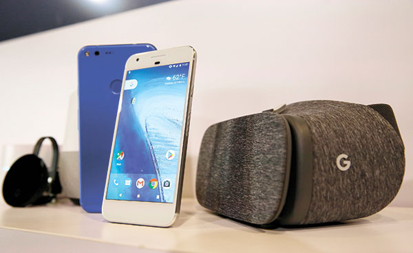 Google's Pixel phone and a Daydream View virtual-reality headset. (AP PHOTO)