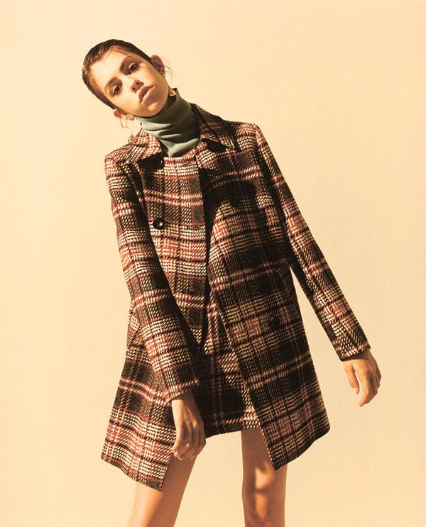 Tweed jacket and skirt coordinates with blue turtleneck top