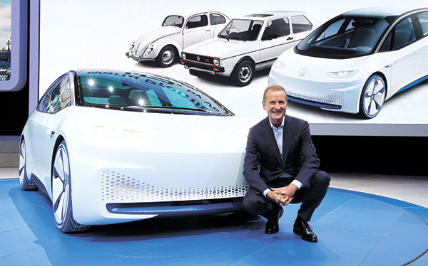Volkswagen CEO Herbert Deiss with the new Volkswagen electric car