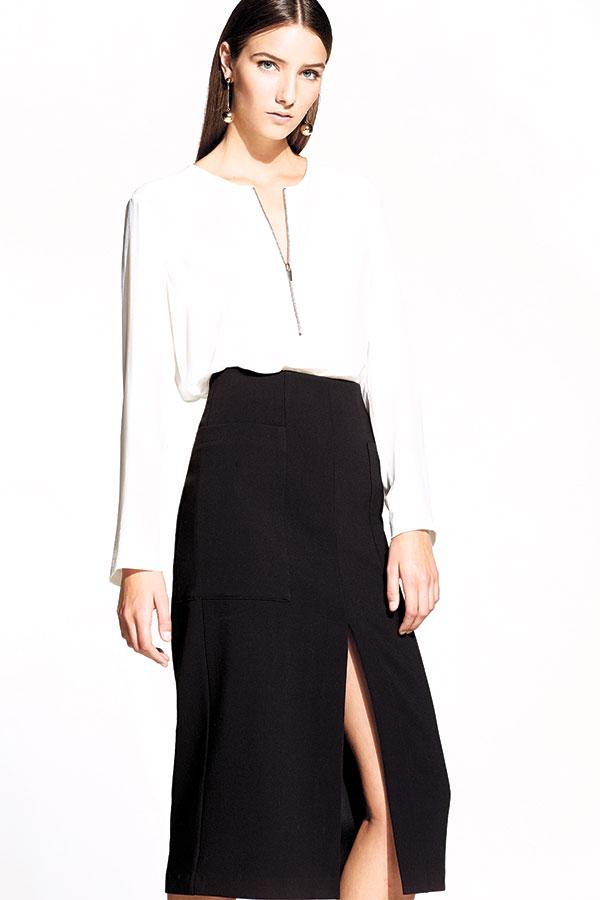 White blouse with zipper detail, black skirt with asymmetrical slit