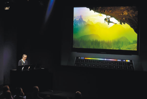 DEMO. An experienced design manager at Adobe Photoshop gives a demonstration of using Touch Bar during an announcement of new Apple products. (AP PHOTO)
