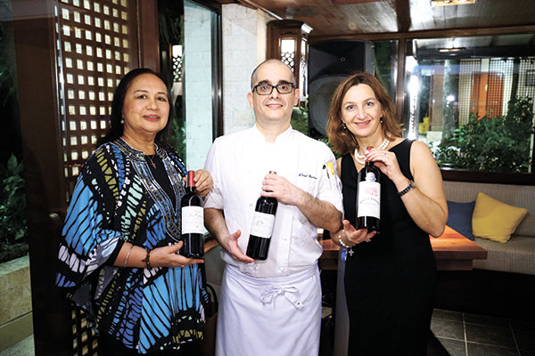 Tita Trillo of Titania Wine Cellar, Executive Sous Chef Daniel Quintero and Nathalie Miara of Les Châteaux de Bordeaux. (CONTRIBUTED PHOTOS)