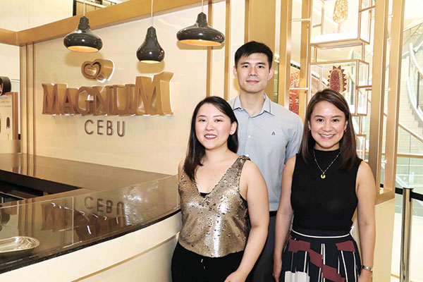 Magnum's Andrea Huang, Brand Manager, Diane Kimberly Tan, Senior Brand Manager, and Drew Tan, Assistant Brand Manager