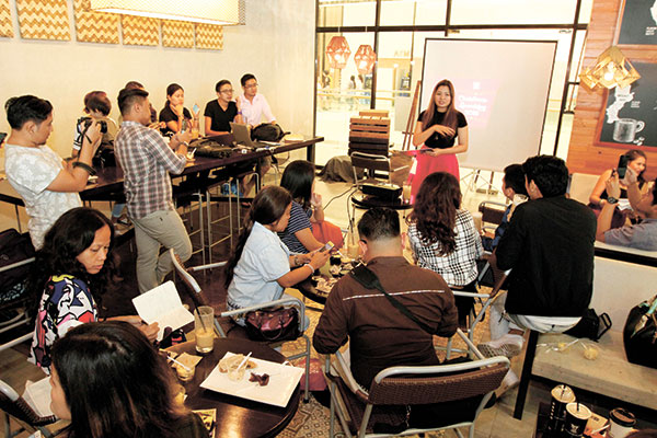 Toni Santos, Bo's Coffee marketing manager, engages guests at the unveiling of the Christmas coffee starter kit.