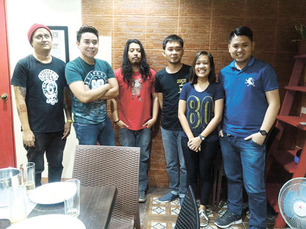 Guest writers Erik Tuban, Manu Avenido and CD Borden with attendee Wilfreda Cabusas and organizer Romeo Bonsocan