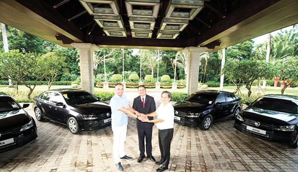 Shangri-La's Mactan Resort & Spa General Manager René Egle, Volkswagen Cebu Branch Manager Ren Dumaraos and NCLPI President Louie Banson