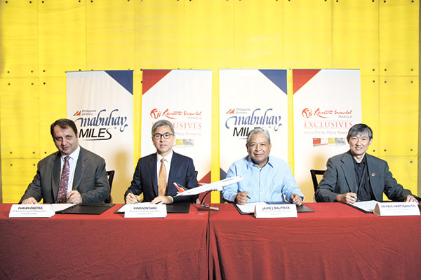 (From left) RWM Chief Gaming Operations and Marketing Officer Hakan Dagtas, RWM President and Chief Executive Officer Kingson Sian, PAL President and Chief Operating Officer Jaime Bautista, and PAL Vice President for Ancillary Business Unit Kevin Hartigan-Go.